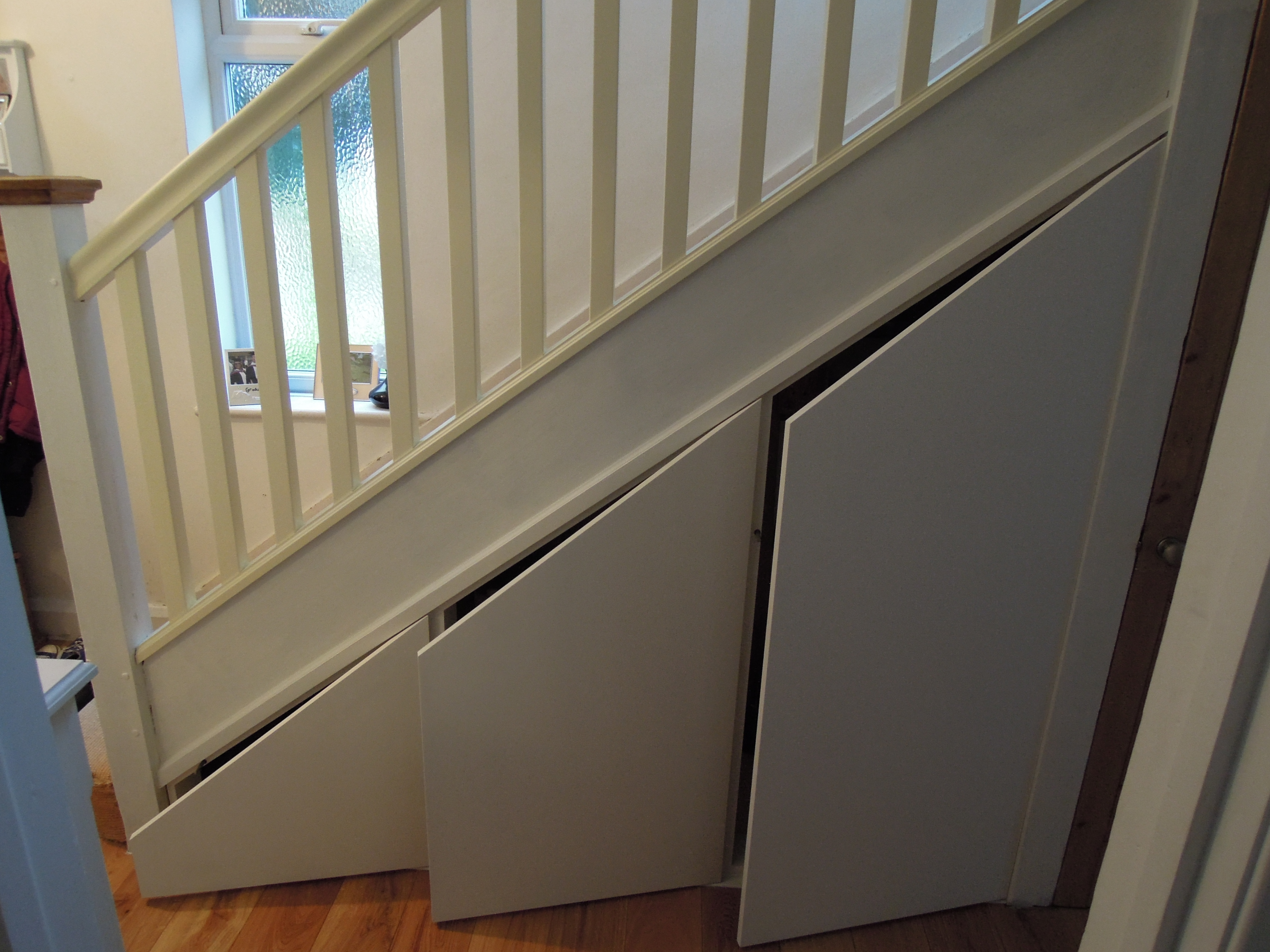 Harrow carpenters lj refurbishments bookcases and cupboards for Door under stairs